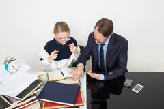 Office. woman looking for information in books. Office. Girl with books. The men speaks on the phone Stock Images
