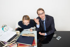 Office. woman looking for information in books Royalty Free Stock Photography