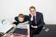 Office. woman looking for information in books. Office. Girl with books. The men speaks on the phone Royalty Free Stock Images