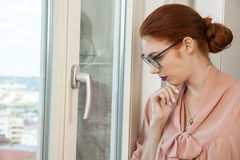 Office Woman Looking Outside Through Glass Window Royalty Free Stock Photo