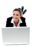 Office woman lying down on floor and working Stock Photo