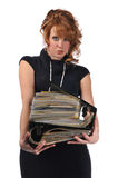 Office woman with a pile of files. Isolated against a white background royalty free stock image