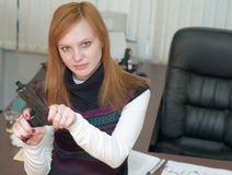 Office, woman, pistol Stock Photo