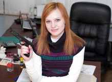 Office, woman, pistol Royalty Free Stock Image