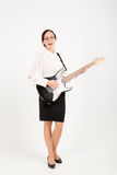 Office woman playing on guitar Royalty Free Stock Image