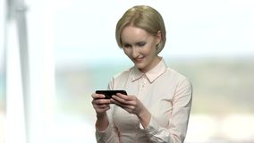 Office woman playing online game on her phone. stock video footage