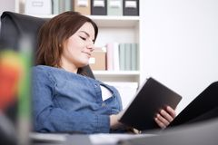 Office Woman Relaxing at her Chair with Tablet stock photography