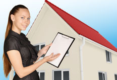 Office woman shows hand in clipboard standing on Stock Images