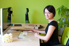 Office woman sitting work business. Office woman sitting work desk business worker green lady Stock Photo