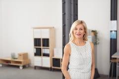 Office Woman in Sleeveless Shirt Smiling at Camera Stock Photo