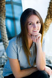 Office  woman smiling. Seated pretty office happy woman outside Stock Image
