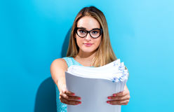 Office woman with a stack of documents. Office woman in glasses with a stack of documents Stock Image