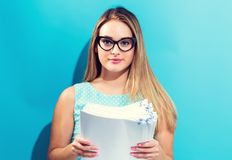 Office woman with a stack of documents Royalty Free Stock Photography