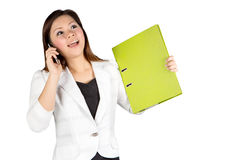 Office woman talking on mobile phone Royalty Free Stock Photography