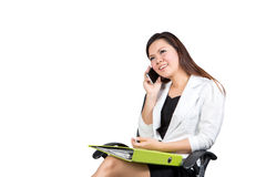 Office woman talking on mobile phone Royalty Free Stock Images