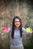 Office woman with two post it Royalty Free Stock Photos