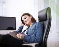 Office Woman Watching Something at her Tablet Royalty Free Stock Images