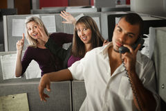Office Women Flirting. Two women flirting with a male coworker in the office royalty free stock photo