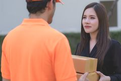 Office woman receiving package from delivery man. Office women is receiving package from delivery man Stock Photo