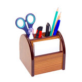 Office wooden stand for pens and pencils. On a white background stock photography