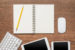 Office wooden table with notebook, yellow pencil, tablet, keyboa Stock Photo