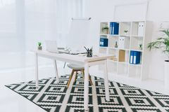 Office with wooden white chair. And table royalty free stock images