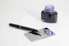 Office work. Foutain pen with office attributes Royalty Free Stock Photography