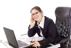 Office Work. A young woman workin in her office, isolated on white Stock Photos