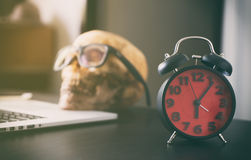 Office work Deadline with dead person skull. Stock Images