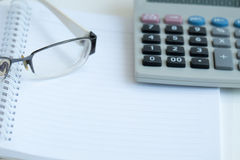 Office Work. Glasses, calculator and book for office work Royalty Free Stock Image