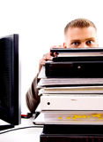 Office work - piled files and man in office Stock Image