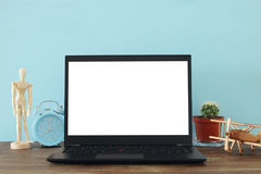 Office work place with open leptop and empty white screen for copy space Royalty Free Stock Photography