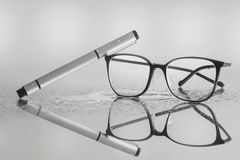 Office work requires glasses and pen royalty free stock image