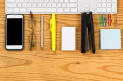 Office work supplies align with computer keyboard on desktop Royalty Free Stock Photography