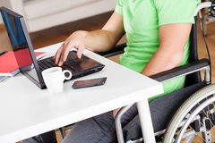 Office work on wheelchair Royalty Free Stock Photo