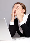 Office worker. Tired woman touching her eyes Royalty Free Stock Photo