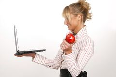 Office worker. Beauty girl with laptop in office stock image