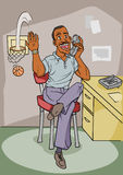 Office Worker African American. Male African American office worker talking on the phone and scoring a basket with a mini ball and hoop Royalty Free Stock Photo