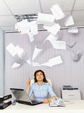 Office worker and annoying documentation. An office worker and annoying, flying documentation royalty free stock images