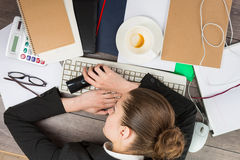 Office worker asleep at his desk Stock Images