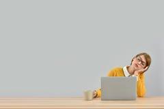 Office worker behing laptop falling asleep Royalty Free Stock Images