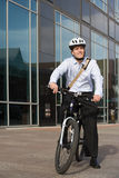 Office worker on bicycle stock photo