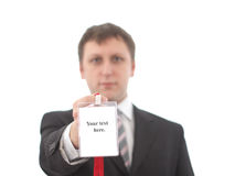 Office worker with blank badges. Shallow depth of field. Focus on the badges Royalty Free Stock Photo