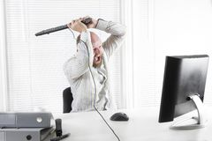 Angry Office worker attack Monitor Royalty Free Stock Photos