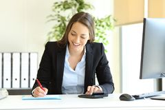 Office worker calculating using calculator royalty free stock image