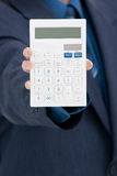 Office worker with calculator Royalty Free Stock Photo