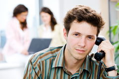 Office Worker Calling On Phone Stock Images
