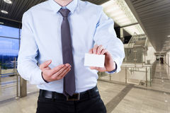 Office worker with card Stock Photography