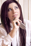 Office worker and cellphone Royalty Free Stock Photography