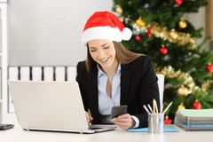 Office worker checking phone messages in christmas. Happy office worker checking phone messages in christmas time stock photo
